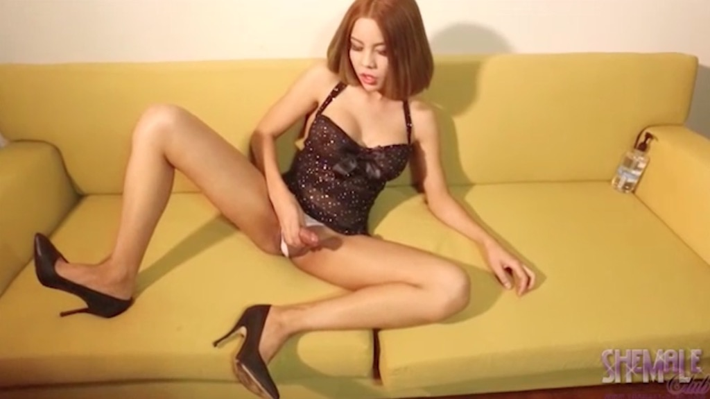 Nadia strokes her juicy penish over the couch.